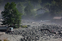 Switzerland. Canton Graubunden. Bregaglia valley. Bondo. A second massive landslide hits Bondo while the remote village is still recovering from a huge landslide caused by a giant rockslide swept down from Piz Cengalo on August 23, 2017. The mudslide smash the carpentry factory and equipment that was being used to clear debris from the previous landslide. 25.08.2017 © 2017 Didier Ruef