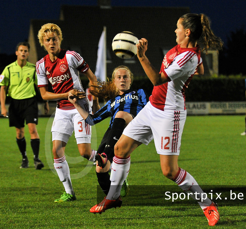 20130830 - VARSENARE , BELGIUM : Brugge's Silke Demeyere (middle) pictured in the middle of a battle with Ajax' Daphne Koster (left) and Ajax' Eshley Bakker during the female soccer match between Club Brugge Vrouwen and Ajax Amsterdam Dames , of the first matchday in the BENELEAGUE competition. Friday 30 August 2013. PHOTO DAVID CATRY