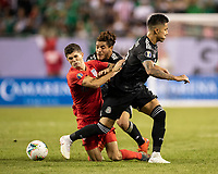 CHICAGO, IL - JULY 7: Christian Pulisic #10 is taken down by Carlos Salcedo #3 and Jonathan Dos Santos #6 during a game between Mexico and USMNT at Soldier Field on July 7, 2019 in Chicago, Illinois.