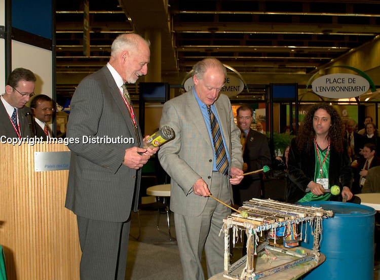 March 19 2003, Montreal, Quebec, Canada<br /> <br /> <br /> David Anderson,Canada's  Environment Minister (L) and Andre Caille, President and CEO of Hydro Quebec and Honorary President of AMERICANA 2003 (R) ,join the SCRAP BAND  to celebrate the opening  of Americana, a 3 days  trade show on environement and waste management organized by Reseau Environnement, March 19, 2003 in Montreal, Canada.<br /> <br /> Mandatory Credit: Photo by Pierre Roussel- Images Distribution. (©) Copyright 2003 by Pierre Roussel <br /> <br /> NOTE : <br />  Nikon D-1 jpeg opened with Qimage icc profile, saved in Adobe 1998 RGB<br /> .Uncompressed  Original  size  file availble on request.