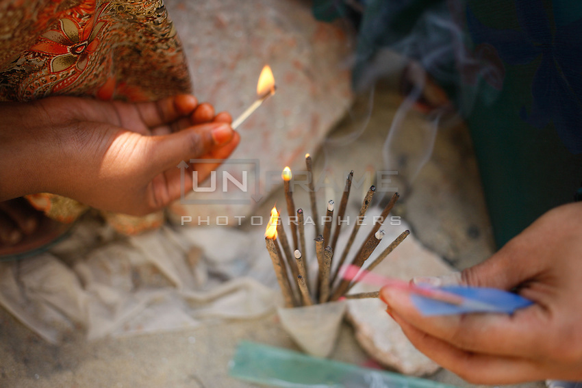 Relatives of victims light Incense sticks as a part of the ritual.