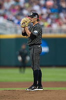 Vanderbilt Commodores pitcher Carson Fulmer (15) looks to his catcher for the sign during the NCAA College baseball World Series against the Cal State Fullerton Titans on June 14, 2015 at TD Ameritrade Park in Omaha, Nebraska. The Titans were leading 3-0 in the bottom of the sixth inning when the game was suspended by rain. (Andrew Woolley/Four Seam Images)