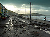 Aberystwyth Promenade strewn with debris after winter storms which caused floods and damage to roads,cars and buildings.<br /> <br /> Stock Photo by Paddy Bergin