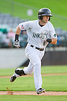 Steve Tolleson (8) of the Charlotte Knights hustles down the first base line during the International League game against the Indianapolis Indians at Knights Stadium on July 22, 2012 in Fort Mill, South Carolina.  The Indians defeated the Knights 17-1.  (Brian Westerholt/Four Seam Images)