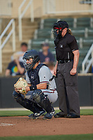 Rome Braves catcher Shea Langeliers (4) and home plate umpire Jennifer Pawol during the game against the Kannapolis Intimidators at Kannapolis Intimidators Stadium on July 2, 2019 in Kannapolis, North Carolina.  The Intimidators walked-off the Braves 5-4. (Brian Westerholt/Four Seam Images)
