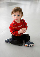 Boy baby sitting on floor looking at camera