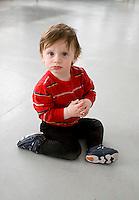 Boy baby sitting on floor looking at camera