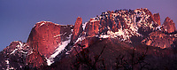 977000002 panoramic view- sunset light turns snow covered castle rock and the surrounding mountain top a soft reddish gold in sequoia national park in california