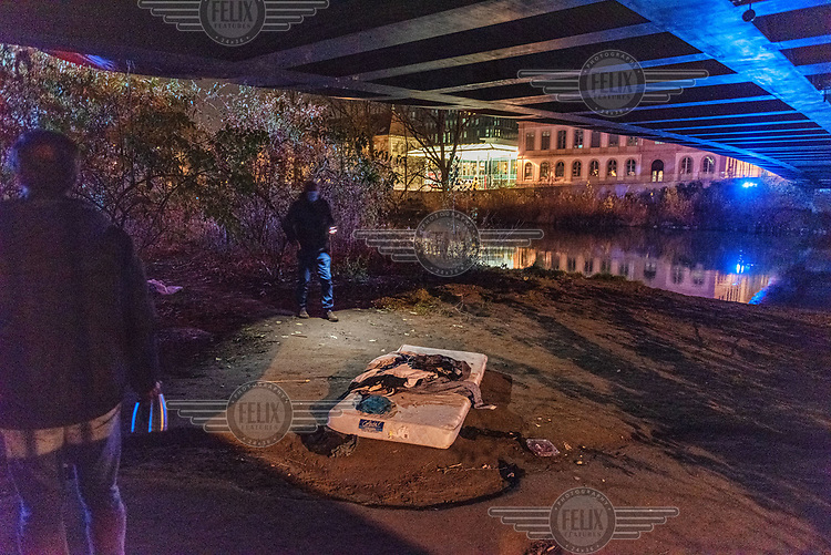 Members of 'le Dream Team', a volunteer organisation, providing emergency aid to people sleeping in the street, discover the wrecked remains of belongings and food of street sleepers- 'someone must have attacked them' - who they had visited only the night before, under the so-called Rolex bridge, by the Arve River running through the city.
