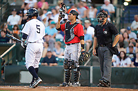 Indianapolis Indians catcher Tony Sanchez #19 and umpire Jeff Gosney during a game against the Empire State Yankees at Frontier Field on August 4, 2012 in Rochester, New York.  Empire State defeated Indianapolis 9-8 in ten innings.  (Mike Janes/Four Seam Images)