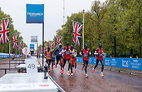4th October 2020, London, England; 2020 London Marathon; The leading pack pass the feeding station on The Mall during the Elite Men's Race. The historic elite-only Virgin Money London Marathon taking place on a closed-loop circuit around St James's Park in central London on Sunday 4 October 2020.