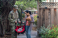 Happy US Army soldier and his wife, daughter with puppy outside home, model-released, stock photo, DoD compliant, for sale, for advertising