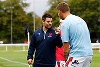 Matas Jurevicius of London Scottish speaks with Aaron Walters during the Championship Cup match between London Scottish Football Club and Nottingham Rugby at Richmond Athletic Ground, Richmond, United Kingdom on 28 September 2019. Photo by Carlton Myrie / PRiME Media Images