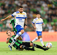 AUSTIN, TX - JUNE 19: Tomas Pochettino #7 of Austin FC strips the ball from Eric Remedi #5 of the SJ Earthquakes with a sliding tackle during a game between San Jose Earthquakes and Austin FC at Q2 Stadium on June 19, 2021 in Austin, Texas.
