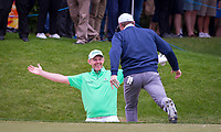 Golfer Stephen Gallagher celebrates after holing from the bunker during the BMW PGA PRO-AM GOLF at Wentworth Drive, Virginia Water, England on 23 May 2018. Photo by Andy Rowland.
