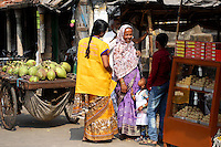 People talking in a small market in Kolkata.<br />