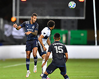 LAKE BUENA VISTA, FL - JULY 26: Khiry Shelton of Sporting KC challenges for a header during a game between Vancouver Whitecaps and Sporting Kansas City at ESPN Wide World of Sports on July 26, 2020 in Lake Buena Vista, Florida.