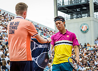 Paris, France, 26 May, 2019, Tennis, French Open, Roland Garros, Kei Nishikori (JPN) receives a towel from a ballboy<br /> Photo: Henk Koster/tennisimages.com