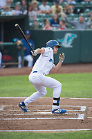 Ogden Raptors center fielder James Outman (47) follows through on his swing during a Pioneer League game against the Great Falls Voyagers at Lindquist Field on August 23, 2018 in Ogden, Utah. The Ogden Raptors defeated the Great Falls Voyagers by a score of 8-7. (Zachary Lucy/Four Seam Images)
