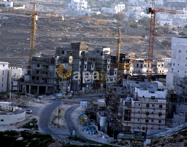 General view of a new neighborhood under construction in Har Homa Jewish settlement near Jerusalem on September 27, 2010. Senior Palestinian official Yasser Abed Rabbo said Monday that President Mahmoud Abbas remains ready to walk out on Mideast peace talks if Israel resumes construction in its West Bank settlements now that building restrictions have expired. Photo by Mahfouz Abu Turk