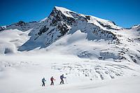Ski touring above the Rhone Glacier while on a ski tour of the Berner Haute Route, Switzerland