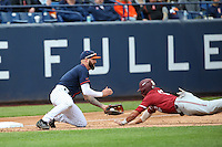 Taylor Bryant #1 of the Cal State Fullerton Titans tags out Duke Kinamon #12 of the Stanford Cardinal at third base during a game at Goodwin Field on February 19, 2017 in Fullerton, California. Stanford defeated Cal State Fullerton, 8-7. (Larry Goren/Four Seam Images)
