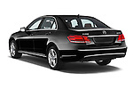 Car pictures of rear three quarter view of a 2015 Mercedes Benz E Class Elegance 4 Door Sedan angular rear