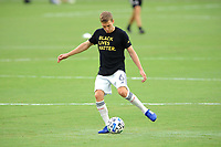 WASHINGTON, DC - AUGUST 25: Scott Caldwell #6 of New England Revolution warming up during a game between New England Revolution and D.C. United at Audi Field on August 25, 2020 in Washington, DC.