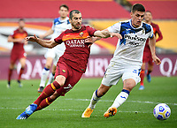 Football, Serie A: AS Roma - Atalanta Olympic stadium, Rome, April 22, 2021. <br /> Roma's Heinrikh Mkhitaryan (l) in action with Atalanta's Joakim Maehle (r) during the Italian Serie A football match between AS Roma and Atalanta at Rome's Olympic stadium, Rome, on April 22, 2021.  <br /> UPDATE IMAGES PRESS/Isabella Bonotto