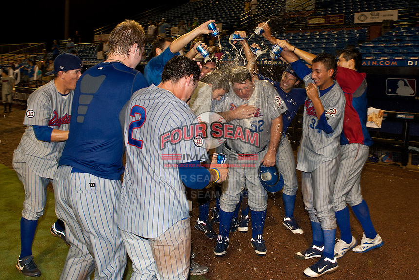 Daytona Cubs players celebrate with Manager Buddy Bailey after winning game 3 of the Florida State League Championship Series against the St. Lucie Mets to win the Florida State League Championship at Digital Domain Park on Spetember 11, 2011 in Port St. Lucie, Florida. Photo by Scott Jontes / Four Seam Images