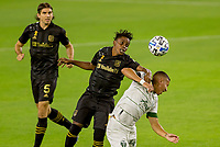 LOS ANGELES, CA - SEPTEMBER 13: Latif Blessing #7 of LAFC and Marvin Loria #44 of the Portland Timbers battle for ball in the air during a game between Portland Timbers and Los Angeles FC at Banc of California stadium on September 13, 2020 in Los Angeles, California.