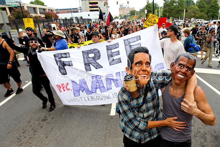 Protestors march through Uptown, Charlotte, before the start of the Democratic National Convention (DNC) September 2, 2012 in Charlotte, North Carolina.
