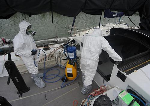 Quirónprevención technicians sanitising a boat deck