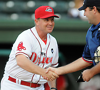 August 13, 2009: Manager Kevin Boles (19) of the Greenville Drive, Class A affiliate of the Boston Red Sox, shakes hands with umpire Matt Cumbee before a game at Fluor Field at the West End in Greenville, S.C. Photo by: Tom Priddy/Four Seam Images
