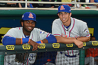 St. Lucie Mets third baseman Aderlin Rodriguez (34) and pitcher Luis Cessa (20) in the dugout before a game against the Fort Myers Miracle on April 18, 2014 at Hammond Stadium in Fort Myers, Florida.  St. Lucie defeated Fort Myers 15-9.  (Mike Janes/Four Seam Images)