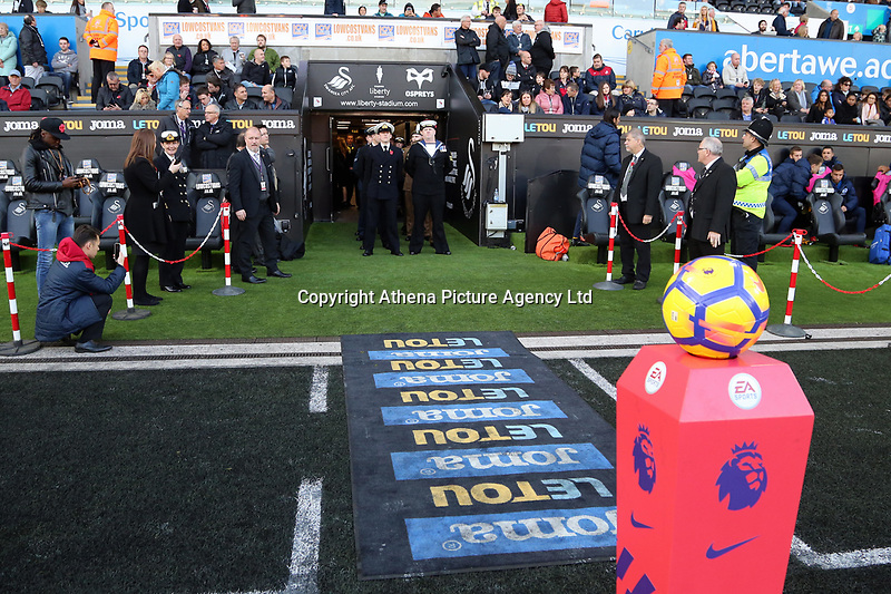 Members of the armed forces lead the players and match officials onto the pitch  during the Premier League match between Swansea City and Brighton and Hove Albion at The Liberty Stadium, Swansea, Wales, UK. Saturday 04 November 2017