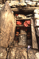 Yemen , Shiban children looking out the window of a typical house