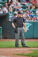 Umpire Bobby Tassone handles the calls behind the plate during the game between the Ogden Raptors and the Billings Mustangs at Lindquist Field on August 17, 2018 in Ogden, Utah. Billings defeated Ogden 6-3. (Stephen Smith/Four Seam Images)