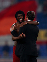 Calcio, Serie A: Roma vs Milan. Roma, stadio Olimpico, 25 aprile 2014.<br /> AS Roma coach Rudi Garcia, of France, greets forward Gervinho, of Ivory Coast, left, at the end of the Italian Serie A football match between AS Roma and AC Milan at Rome's Olympic stadium, 25 April 2014. AS Roma won 2-0.<br /> UPDATE IMAGES PRESS/Isabella Bonotto
