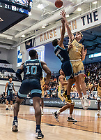WASHINGTON, DC - FEBRUARY 8: Chase Paar #3 of George Washington defends against Fatts Russell #1 of Rhode Island during a game between Rhode Island and George Washington at Charles E Smith Center on February 8, 2020 in Washington, DC.
