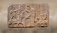 "Aslantepe Hittite relief sculpted orthostat stone panel. Limestone, Aslantepe, Malatya, 1200-700 B.C. Anatolian Civilisations Museum, Ankara, Turkey.<br /> <br /> Scene of king's offering drink and sacrifice to the god. The god is on the deer, with the bow attached to his shoulder and with a triple bundle of lightning in his hand. The king looks at the god, and makes the libation to the god while carrying a scepter with a curled end - lituus. Behind the king is a servant holding a goat for sacrifice to the god. Hieroglyphs read; ""God Parata, Strong King... "". <br /> <br /> Against a brown art background."