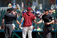 Umpires Darius Ghani, Andrew Barrett, and Brian Walsh (clockwise) during the lineup exchange before a Texas League game between the Amarillo Sod Poodles and Frisco RoughRiders on May 19, 2019 at Dr Pepper Ballpark in Frisco, Texas.  (Mike Augustin/Four Seam Images)