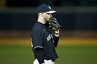 Wake Forest Demon Deacons third baseman Jake Mueller (23) chews on his glove between pitches during the game against the Illinois Fighting Illini at David F. Couch Ballpark on February 16, 2019 in  Winston-Salem, North Carolina.  The Fighting Illini defeated the Demon Deacons 5-2.  (Brian Westerholt/Four Seam Images)