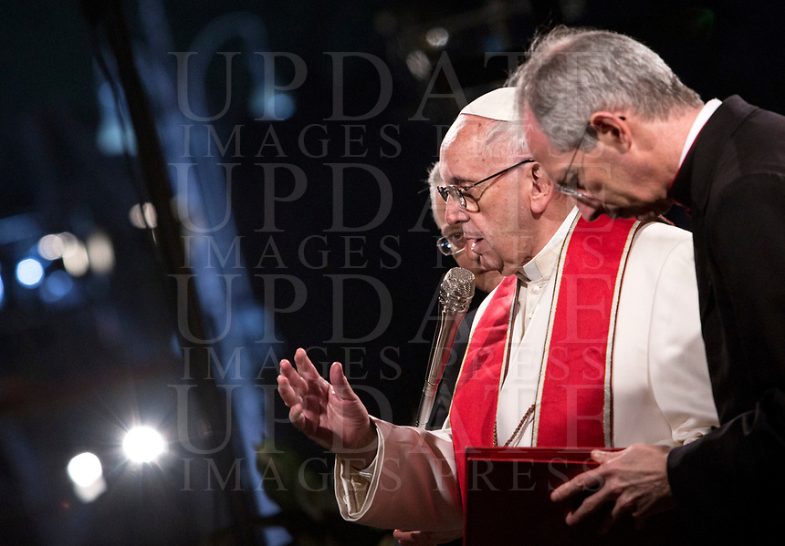 Pope Francis blesses the faithful after presiding over the Via Crucis (Way of the Cross) on Good Friday, in front of the Colosseum, in Rome, March 30, 2018.<br /> UPDATE IMAGES PRESS/Riccardo De Luca<br /> <br /> STRICTLY ONLY FOR EDITORIAL USE