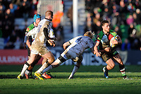 Ben Botica of Harlequins goes round Scott MacLeod of Newcastle Falcons during the Aviva Premiership match between Harlequins and Newcastle Falcons at the Twickenham Stoop on Saturday 15th February 2014 (Photo by Rob Munro)
