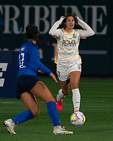 TACOMA, WA - OCTOBER 17: Arielle Ship #17 of Utah Royals FC reacts after not getting to a pass while Sam Hiatt #27 of OL Reign FC defends during a game between Utah Royals FC and OL Reign at Cheney Stadium on October 17, 2020 in Tacoma, Washington.