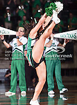 A North Texas Mean Green does a high kick during the NCAA Women's basketball game between the Arkansas State Red Wolves and the University of North Texas Mean Green at the North Texas Coliseum,the Super Pit, in Denton, Texas. Arkansas State defeated UNT 62 to 59