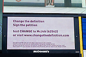 McDonald's illuminated sign at Picadilly Circus, London, advertising a petition campaigning for a change in the dictionary definition of McJob.