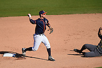 Cal State Fullerton Titans infielder Jake Jefferies (4) throws to first during a game against the Alabama State Hornets on February 14, 2015 at Bright House Field in Clearwater, Florida.  Alabama State defeated Cal State Fullerton 3-2.  (Mike Janes/Four Seam Images)
