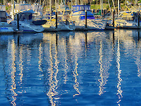 Reflected sailing masts and boats at Monterey Harbor and Marina, California
